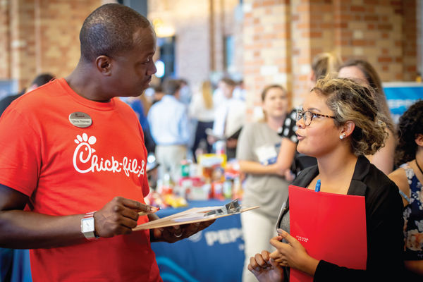 A student talks to a recruiter from Chick-fil-a during the Fall Career Fair.