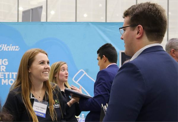 A student talks to a recruiter during the 2019 Fall Career Fair.